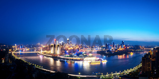 cityscape and skyline of downtown near water of chongqing at twilight