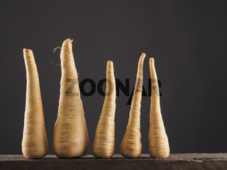 Raw parsnip in row