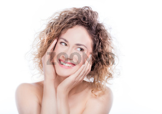 Young smiling woman with curly hair portrait on white