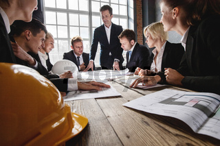 Construction architects in office