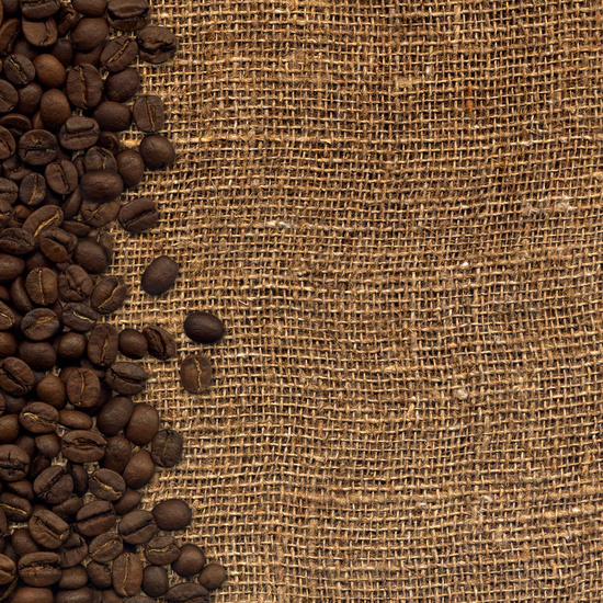 card with coffee beans on background sacking
