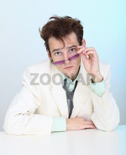 Funny disheveled young man in glasses