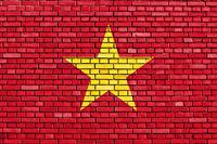 flag of Vietnam painted on brick wall