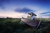 The sunsets on the old boat abandoned on Thornham Saltmarsh, Norfolk.