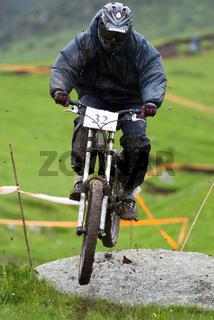 Biker jump on dirty downhill race