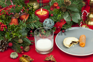 Christmas table with a glass of milk and mince pie