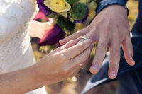 The bride wears a ring on the finger of the close-up
