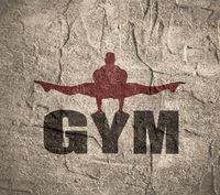 Muscular man posing on gym word.