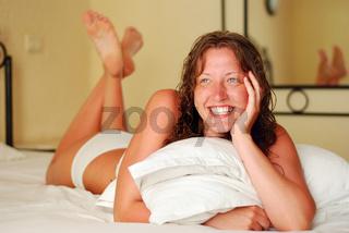 woman is smiling in bedroom