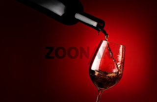 Wineglass on a red background