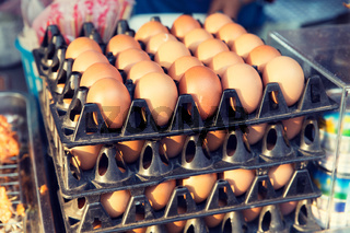 fresh eggs on tray at asian street market