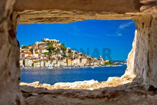 Historic town of Sibenik waterfront view through stone window