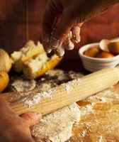 Baker working fresh bread dough