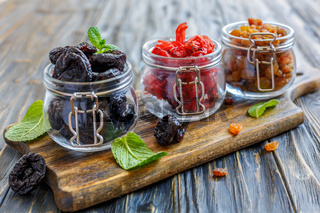 Prunes, dried hibiscus blossoms and raisins in jars.