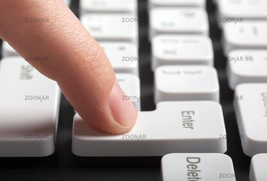 Finger pushing enter button