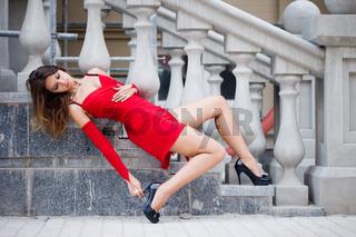 Beautiful woman near the stairs