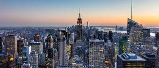 New York City skyline with urban skyscrapers at dusk, USA.