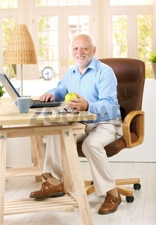 Older man working in his study