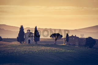 Tuscany landscape at sunrise. Chapel of Madonna di Vitaleta, San Quirico d#39;Orcia, Italy