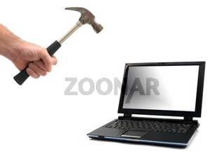 A metal hammer smashing a laptop  isolated against a white background