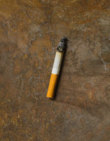 one used burned cigarette on rusty metal backgrounds