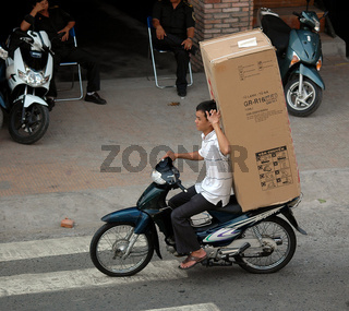 Transport mit Moped in Saigon