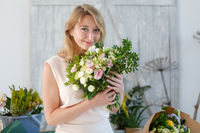 Beautiful blonde in flower shop