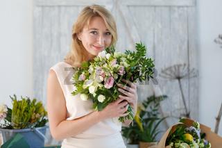 Beautiful blonde in flower shop