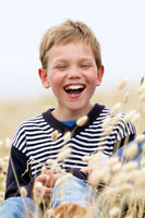 blond child laughing in nature
