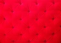 Red velvet fabric texture background pattern closeup