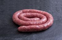 Rolled uncooked botifarra or Catalan sausage