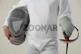 Female fencer hold the epee and rencer mask isolated on white background