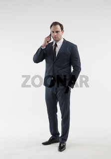 Portrait of a mature businessman with smartphone on white background