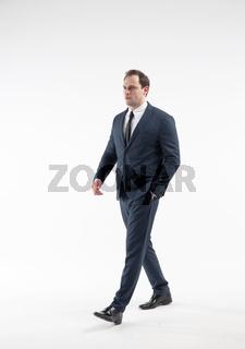 Portrait of walking mature businessman isolated on white background