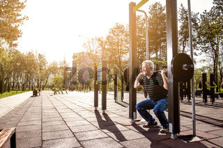 Lifting weights in Outdoors Gym
