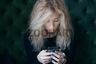 girl watching something in the smartphone