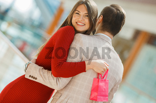 Couple hug in shopping mall