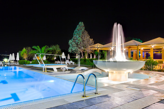 Water pool and fountain at night
