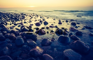 Beautiful seascape of Baltic sea rocky shore. Photo with vintage mood.