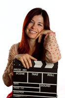 Woman resting on a clapperboard