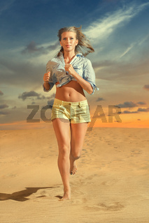 Young woman running on the sand