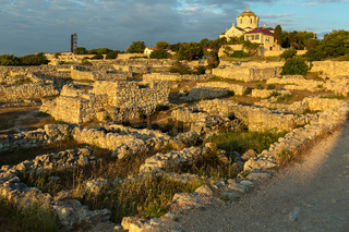 Ancient ruins Chersonesus Taurica in the rays of setting sun.