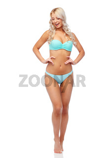 happy smiling young woman in bikini swimsuit