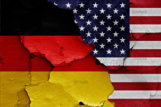 flags of Germany and USA painted on cracked wall