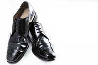 Black Corporate Shoes on white reflective surface
