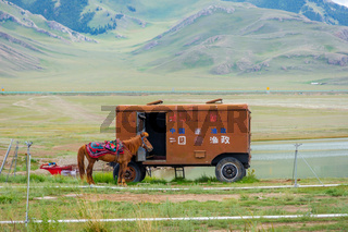 Horse and caravan, Sayram lake, China