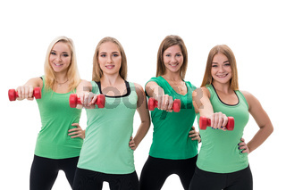Pretty sportswomen in green tops with dumbbells
