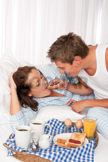 Young man and woman having breakfast together