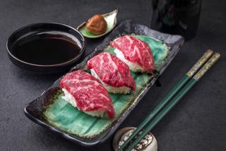 Traditional Japanese Wagyu Nigiri Sushi with Umiboshi as close-up on a bowl