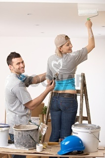 Couple having fun at painting